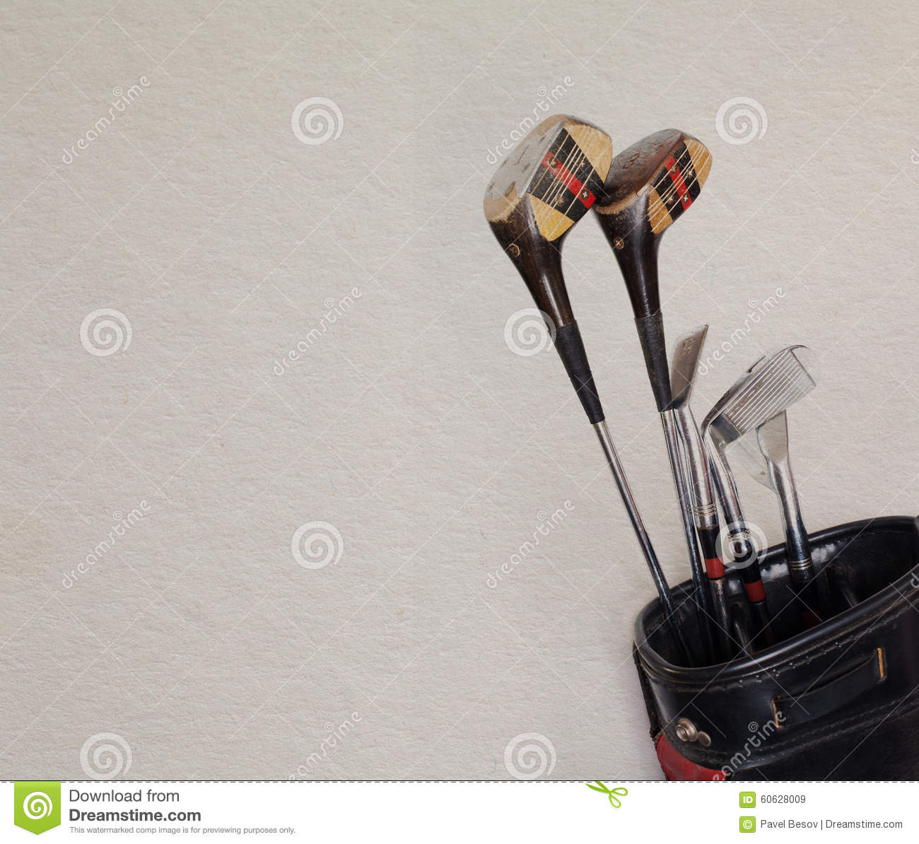 Retro golf clubs in an old leather bag, copy space