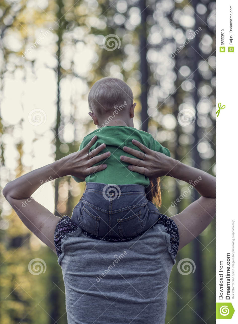 Retro image of a mother walking with her baby son