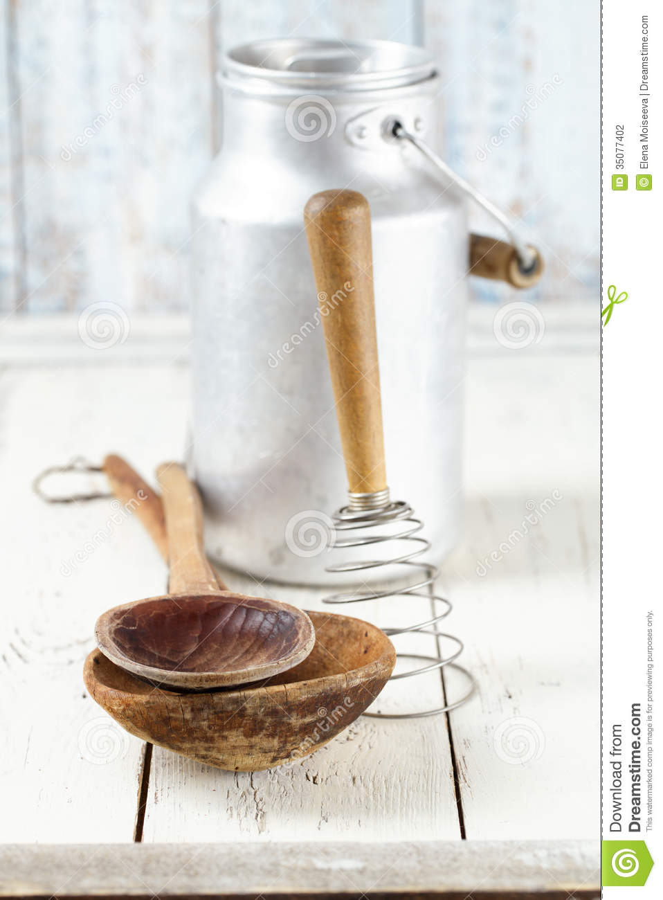Retro kitchen utensils tools on old wooden table in rustic for Table utensils