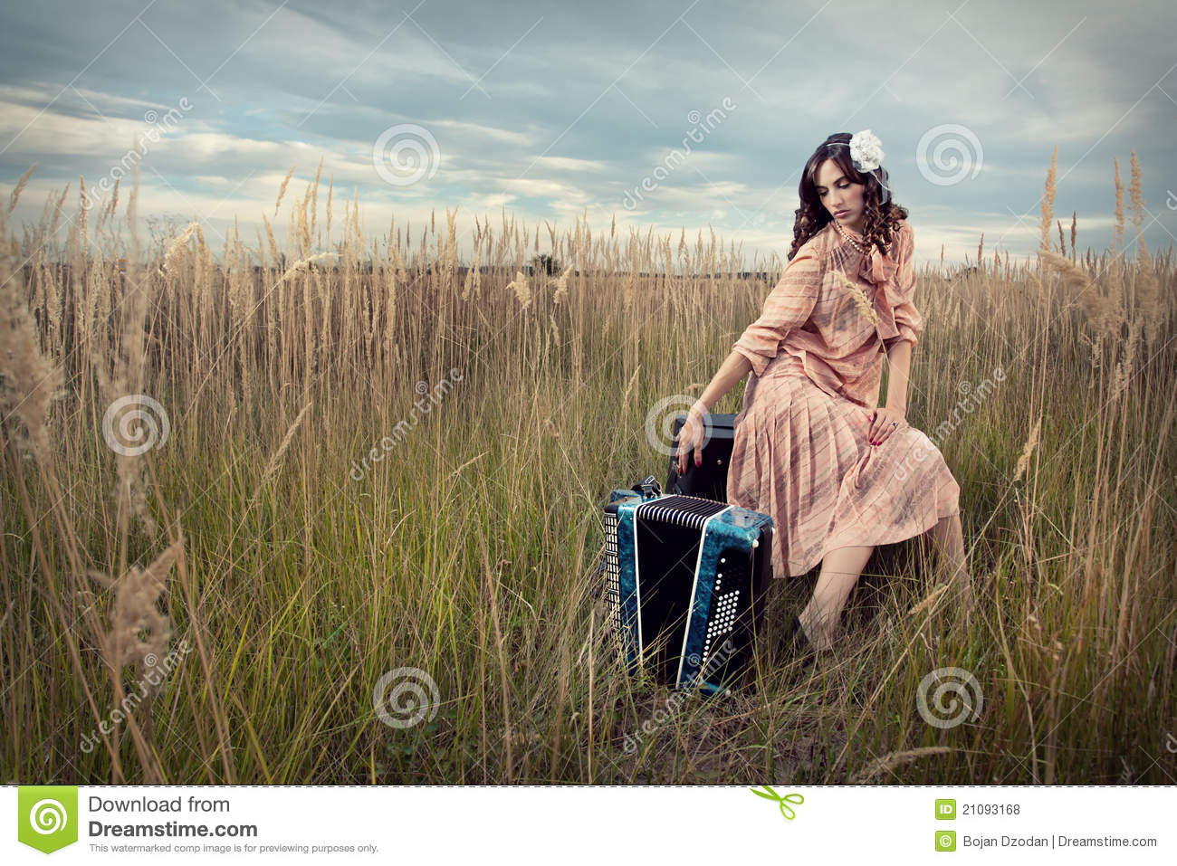 Retro lady in field with accordion