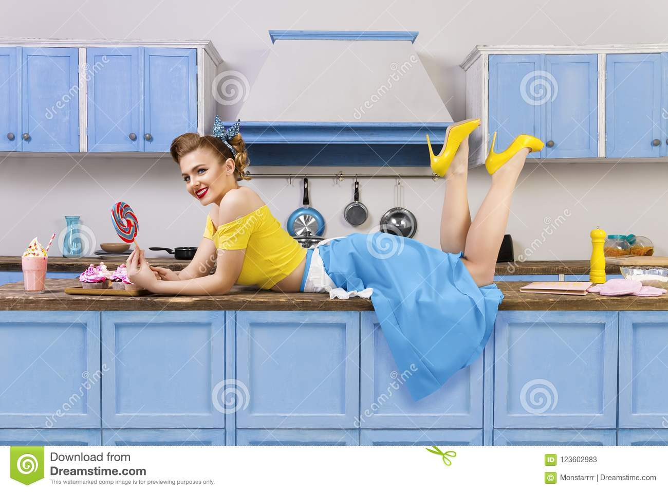 Retro pin up girl woman lying relaxing on kitchen