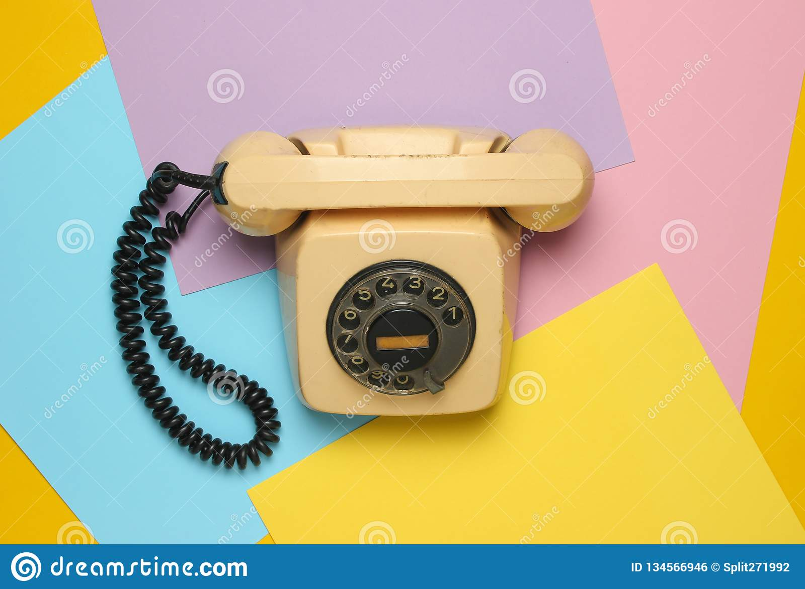 Retro Rotary Phone From 80s On A Colored Pastel Background