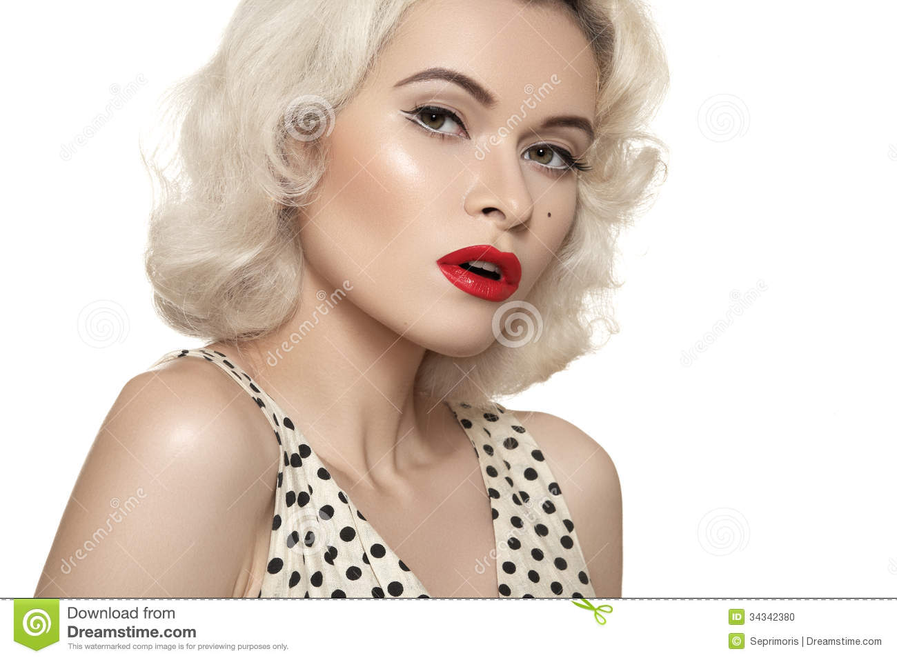 Retro 50s. Old fashioned pin-up model, red lips make-up, blond curly hairstyle