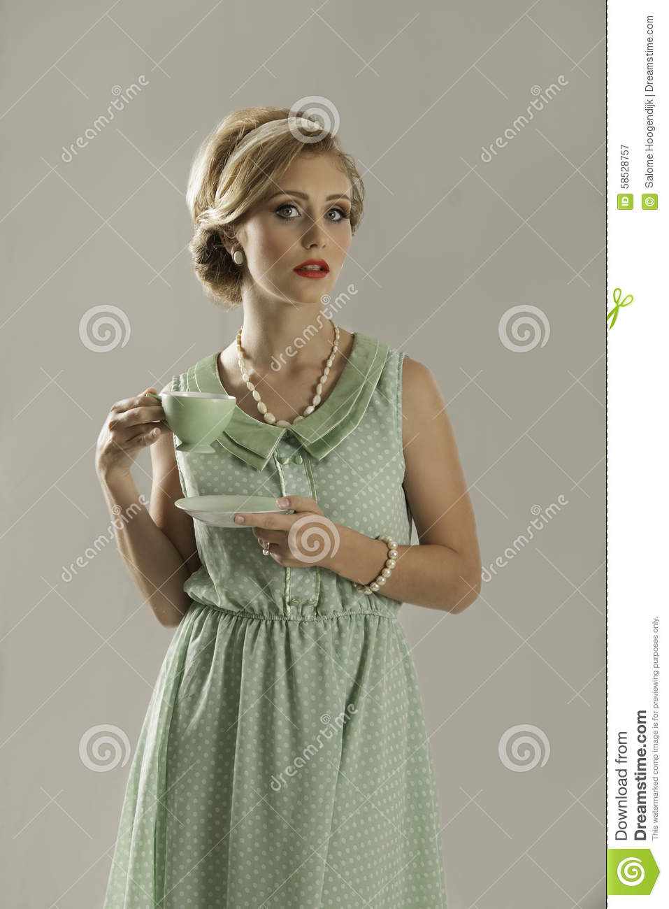Retro 1950s Woman With Porcelain Teacup Stock Image
