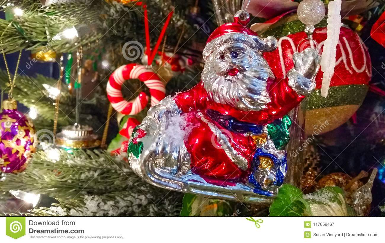 Retro Santa On Sled Waving Ornament On Old Fashioned Christmas Tree ...