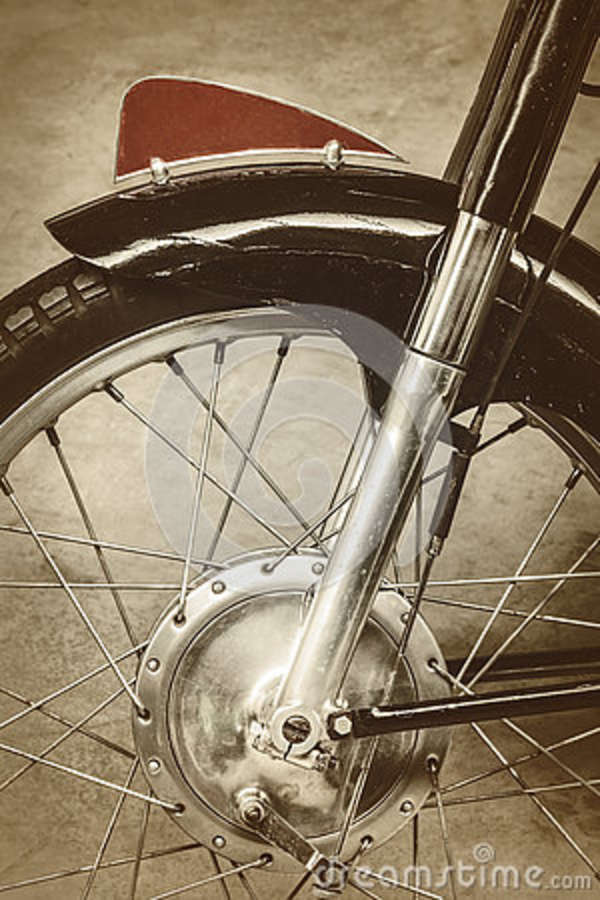 Retro styled image of the front of an old motorcycle