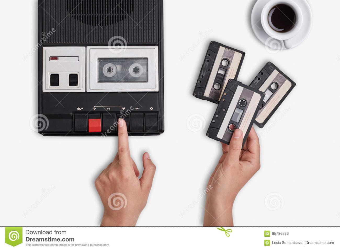 Retro tape recorder, cassettes and cup of hot coffee standing on white surface. Hands switching on cassette tape recorder changing