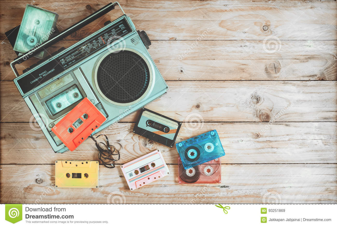 retro technology of radio cassette recorder music with retro tape cassette on wood table
