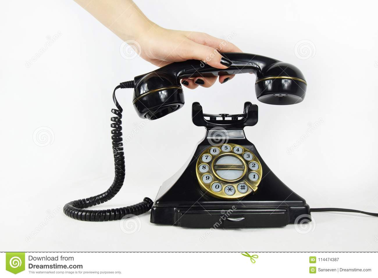 Retro Telephone, hand picking up the receiver