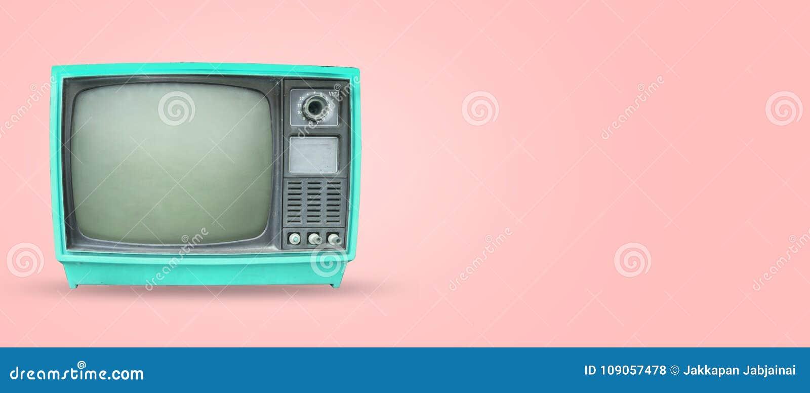 Old vintage tv on pastel color background.