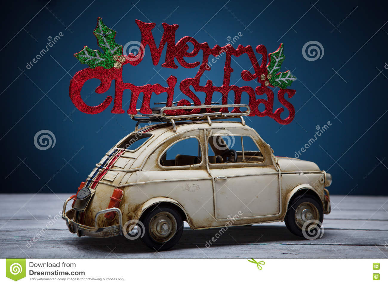 Retro Toy Car With Merry Christmas Sign Stock Image