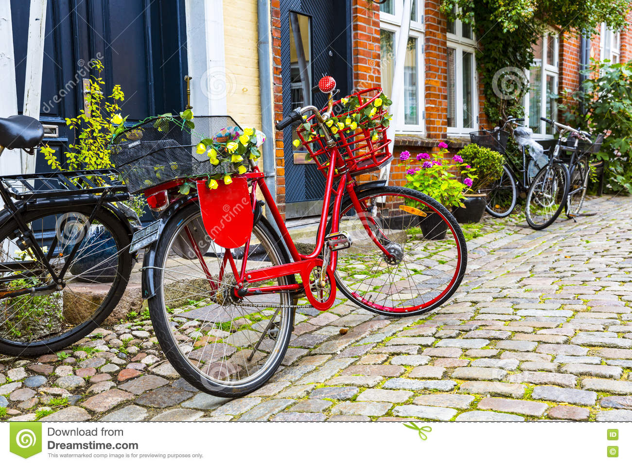 Retro Vintage Red Bike On Cobblestone Street In The Old