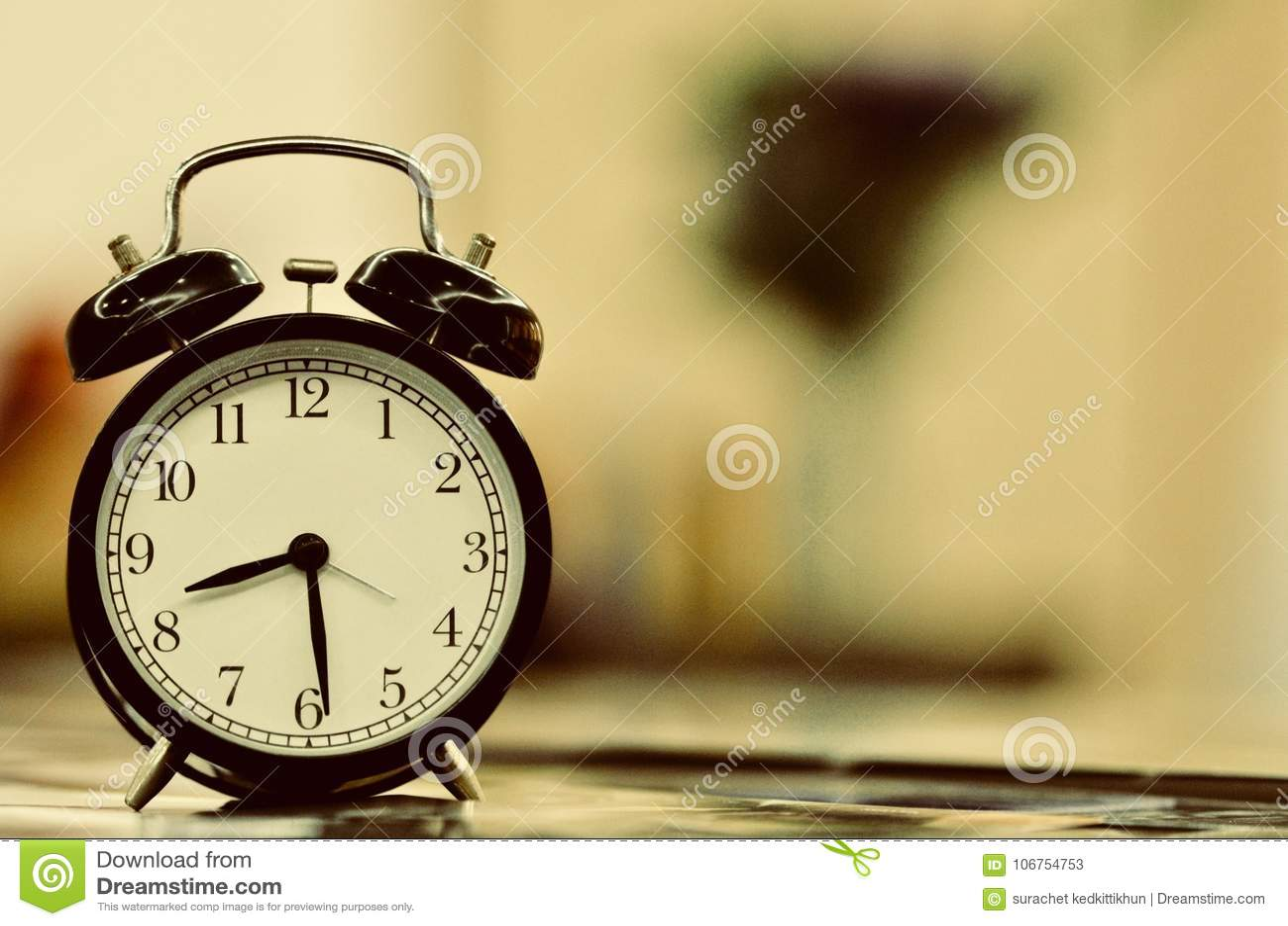 Retro Vintage Style Classic White Alarm Clock On Vintage Bedroom