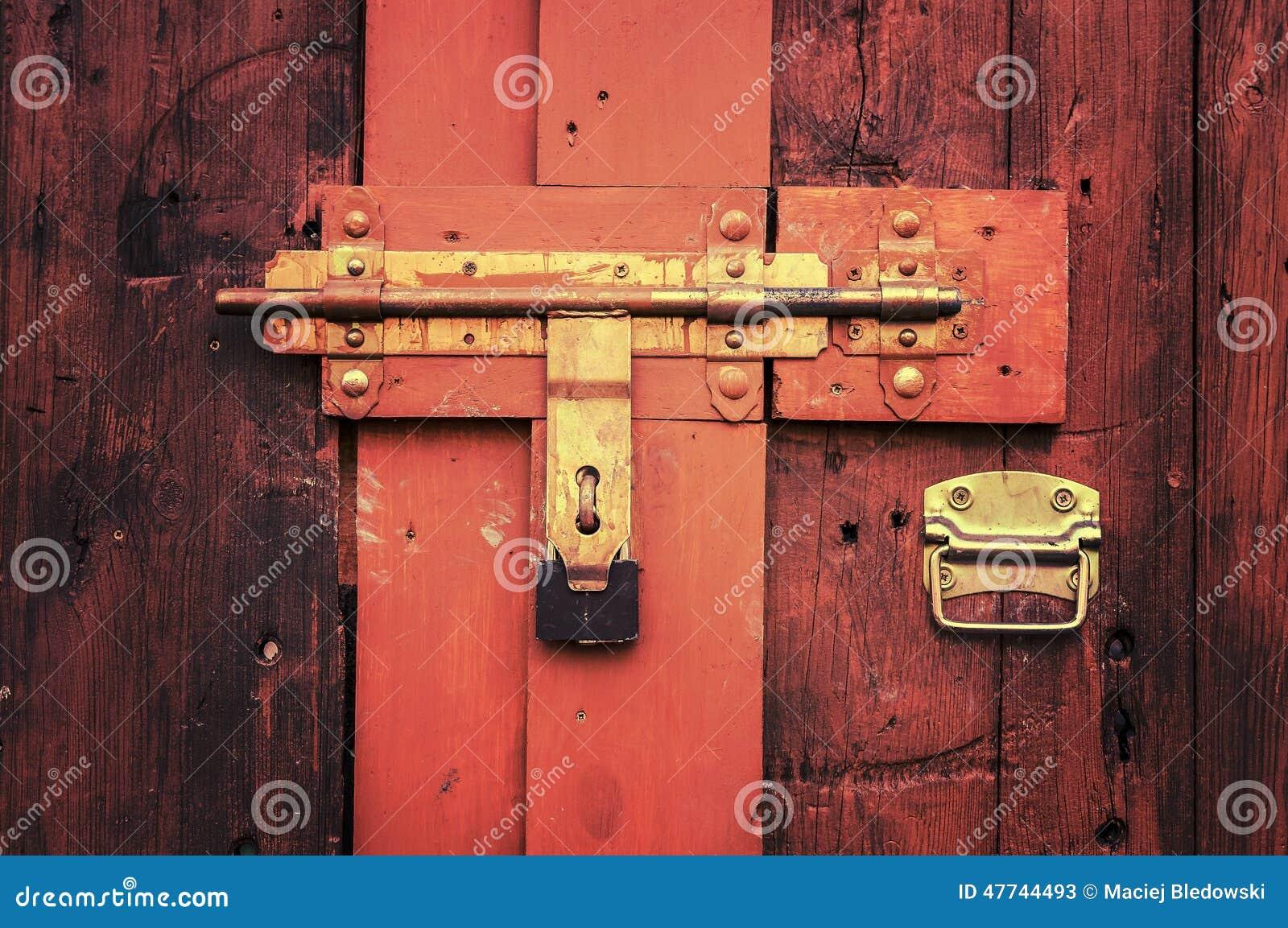 Retro vintage style picture of wooden door with lock for 1950s front door styles
