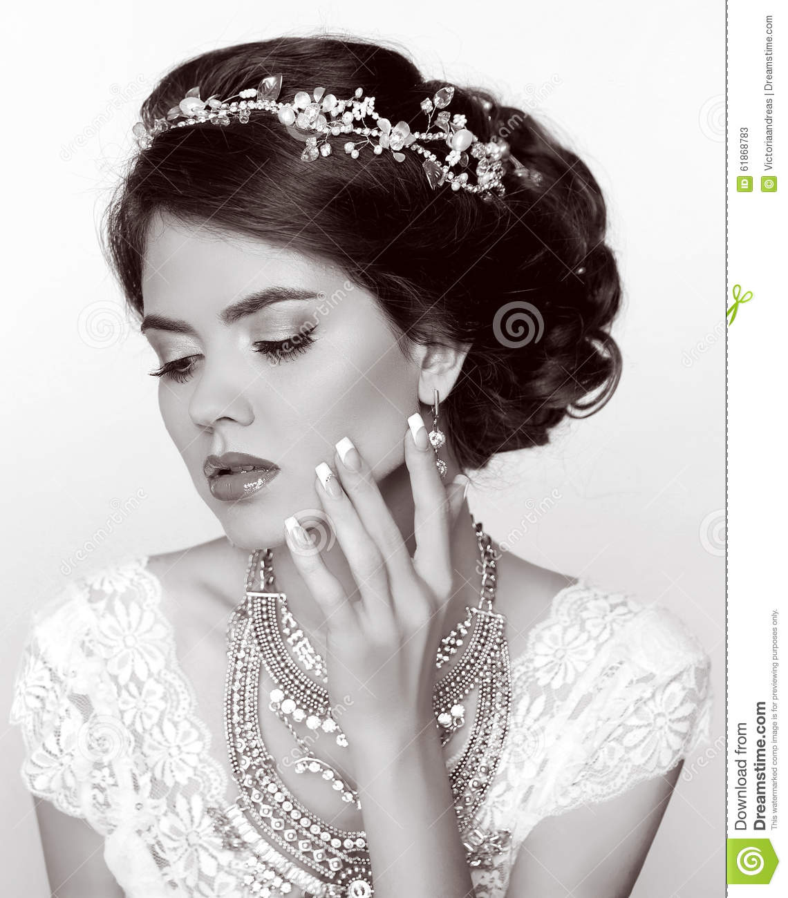 Retro woman. Beautiful bride with elegant hairstyle, with precious jewels, manicured nails. Makeup.