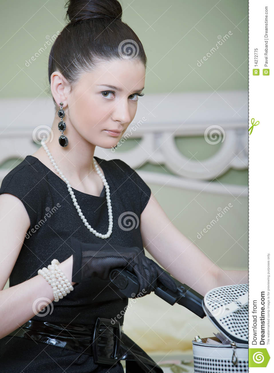 Retro woman with a gun in a hotel woman