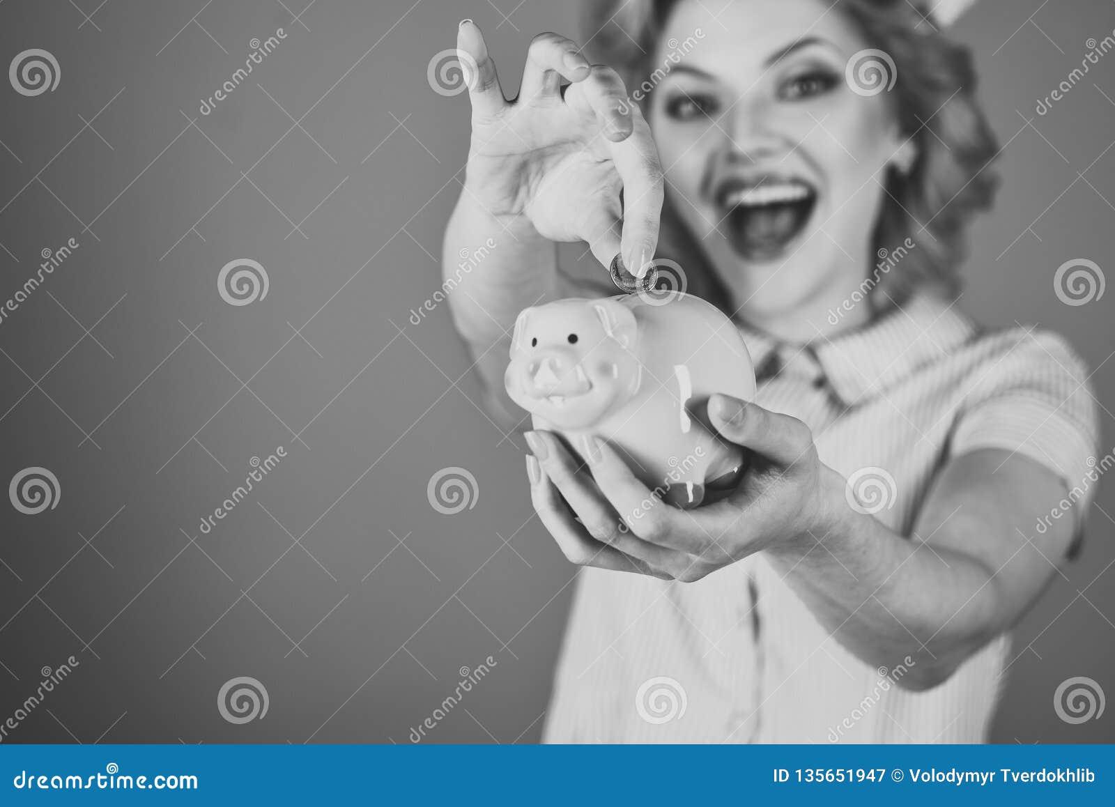 Retro woman hold moneybox, piggy bank for savings