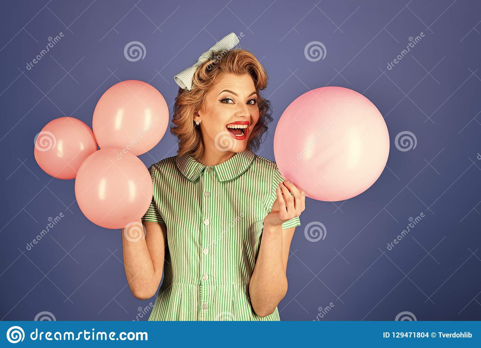 Retro woman with party balloons, celebration.
