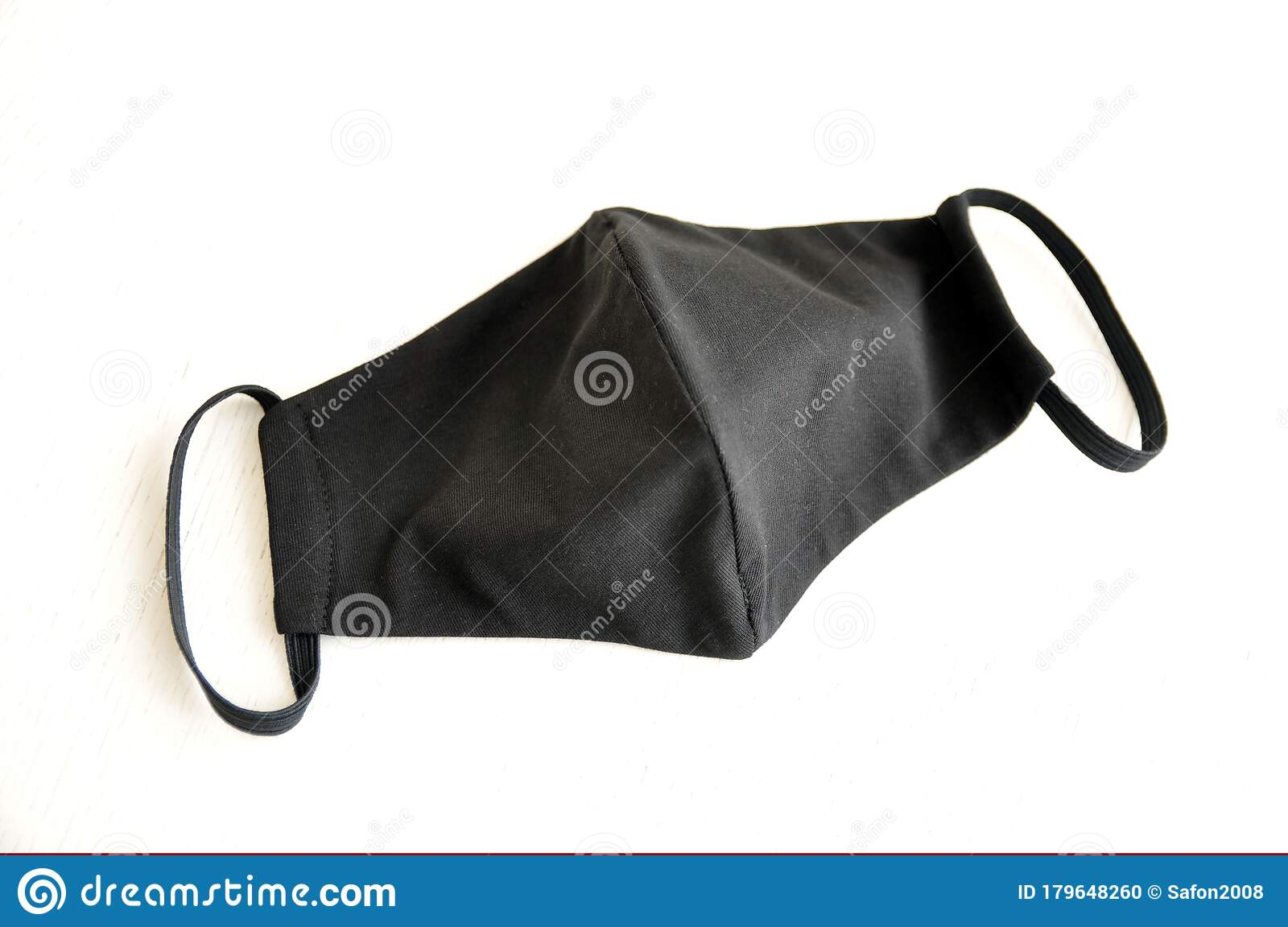 Reusable Respiratory Mask Made Of Black Fabric With Elastic Bands