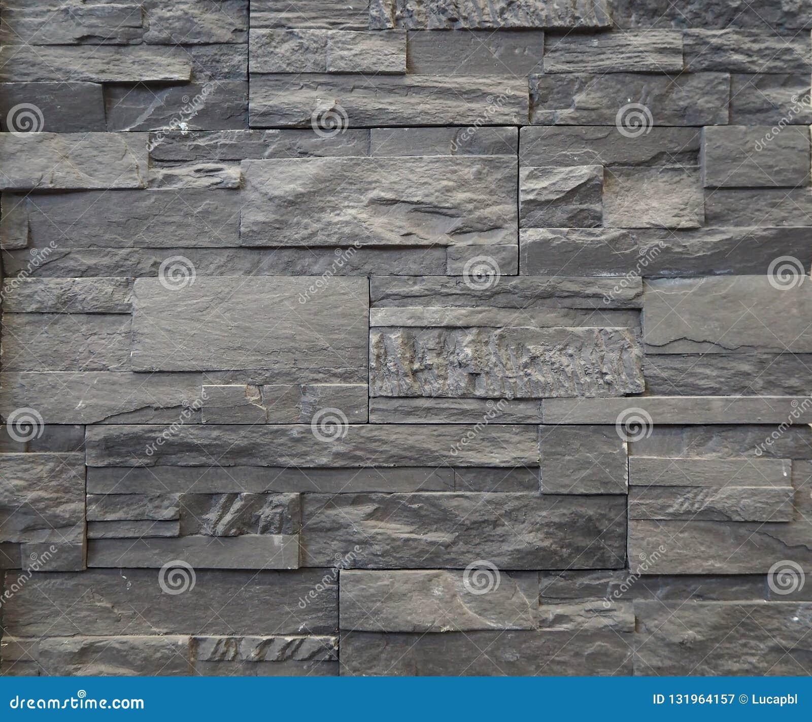 Revetement Mur Exterieur Pierre revêtement de mur en pierre fait de blocs et briques gris