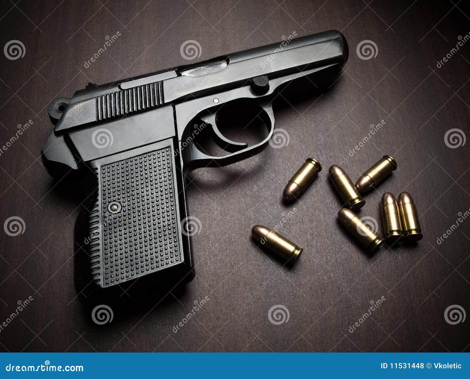 Revólver com balas