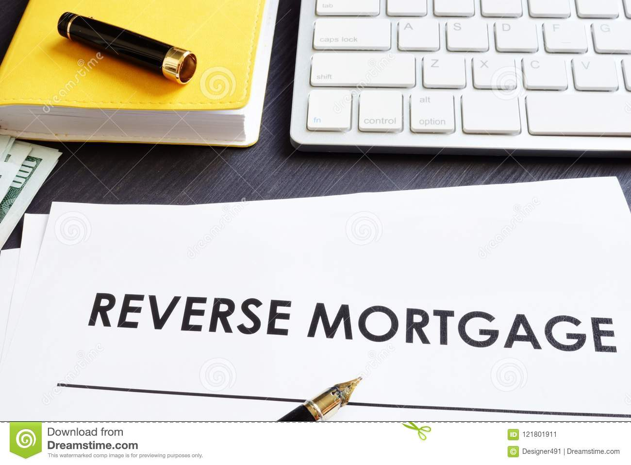 Reverse mortgage agreement and pen.