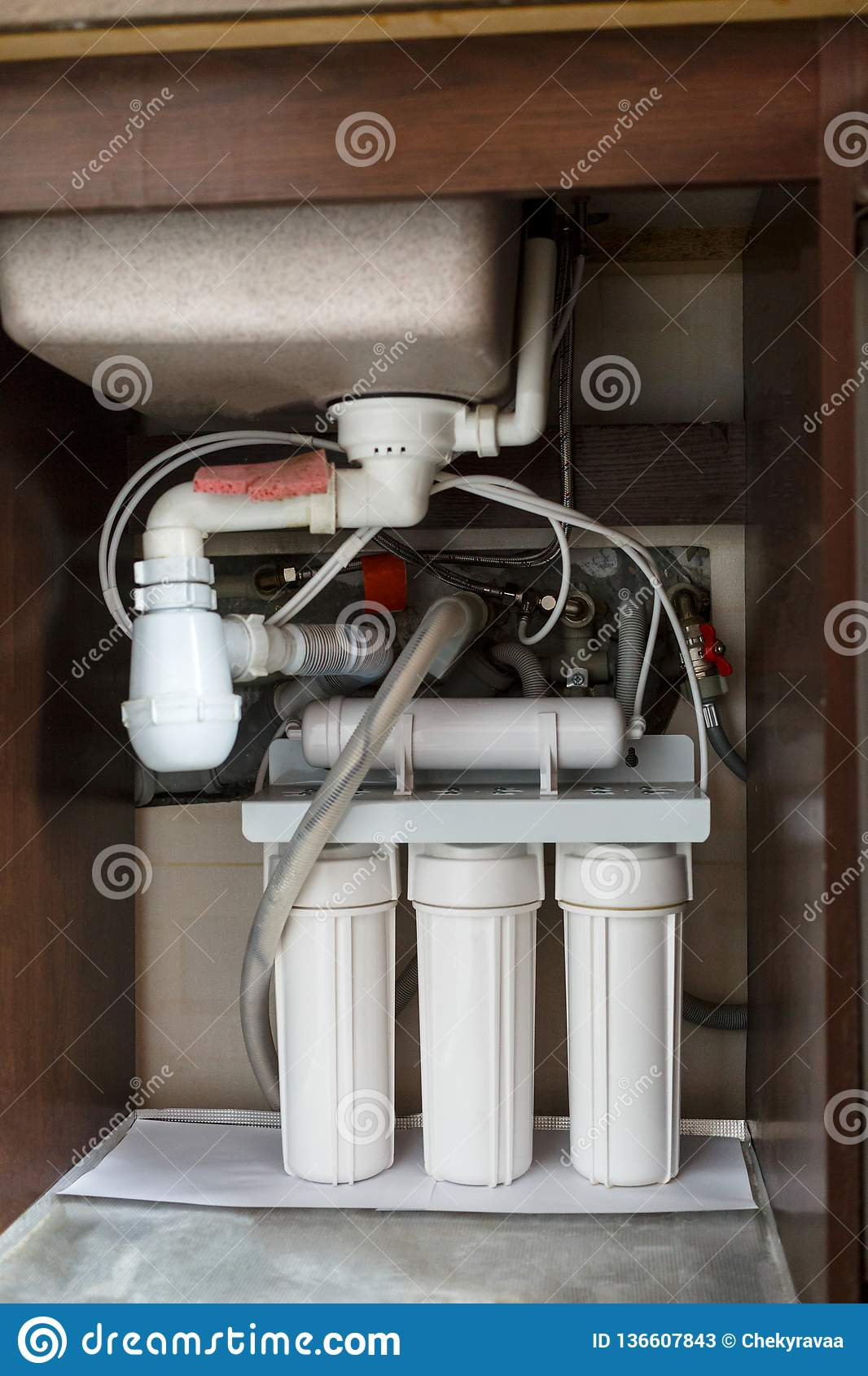 Reverse osmosis water purification system at home installation of water purification filters under kitchen sink