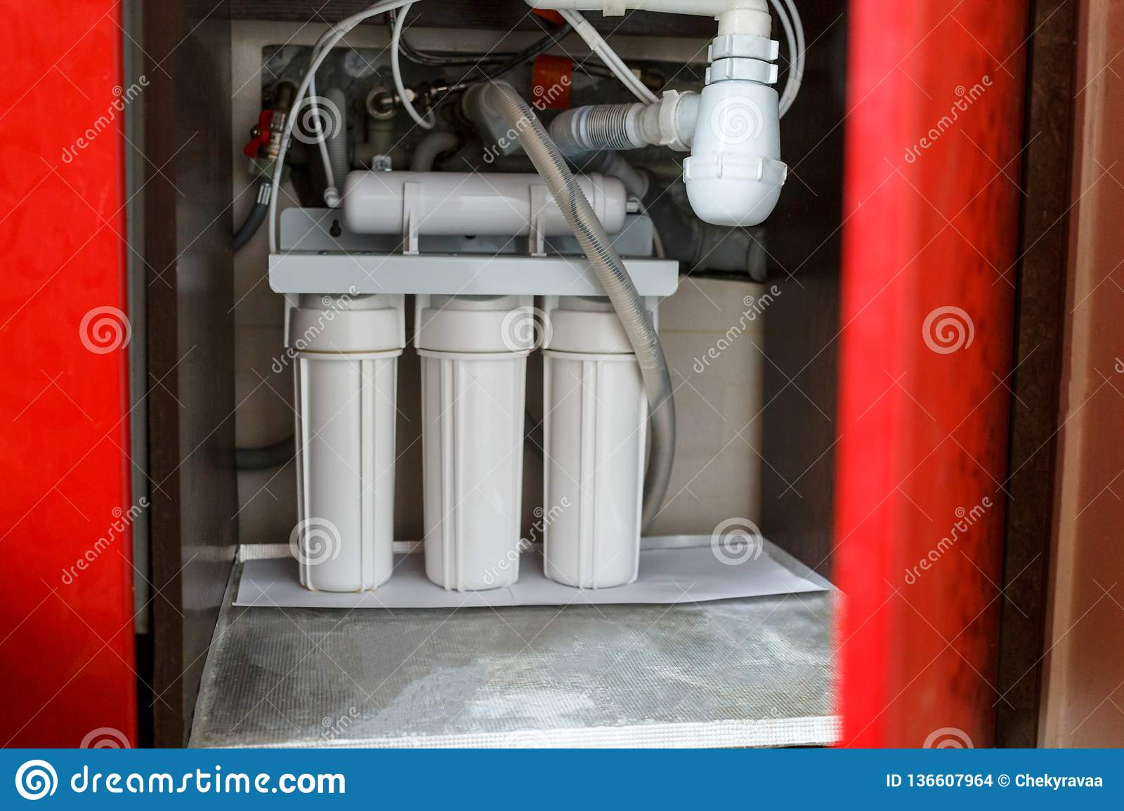 Reverse Osmosis Water Purification System At Home. Installation Of on clear glass sink, clear kitchen counter, clear kitchen cabinets, clear bathroom sink,