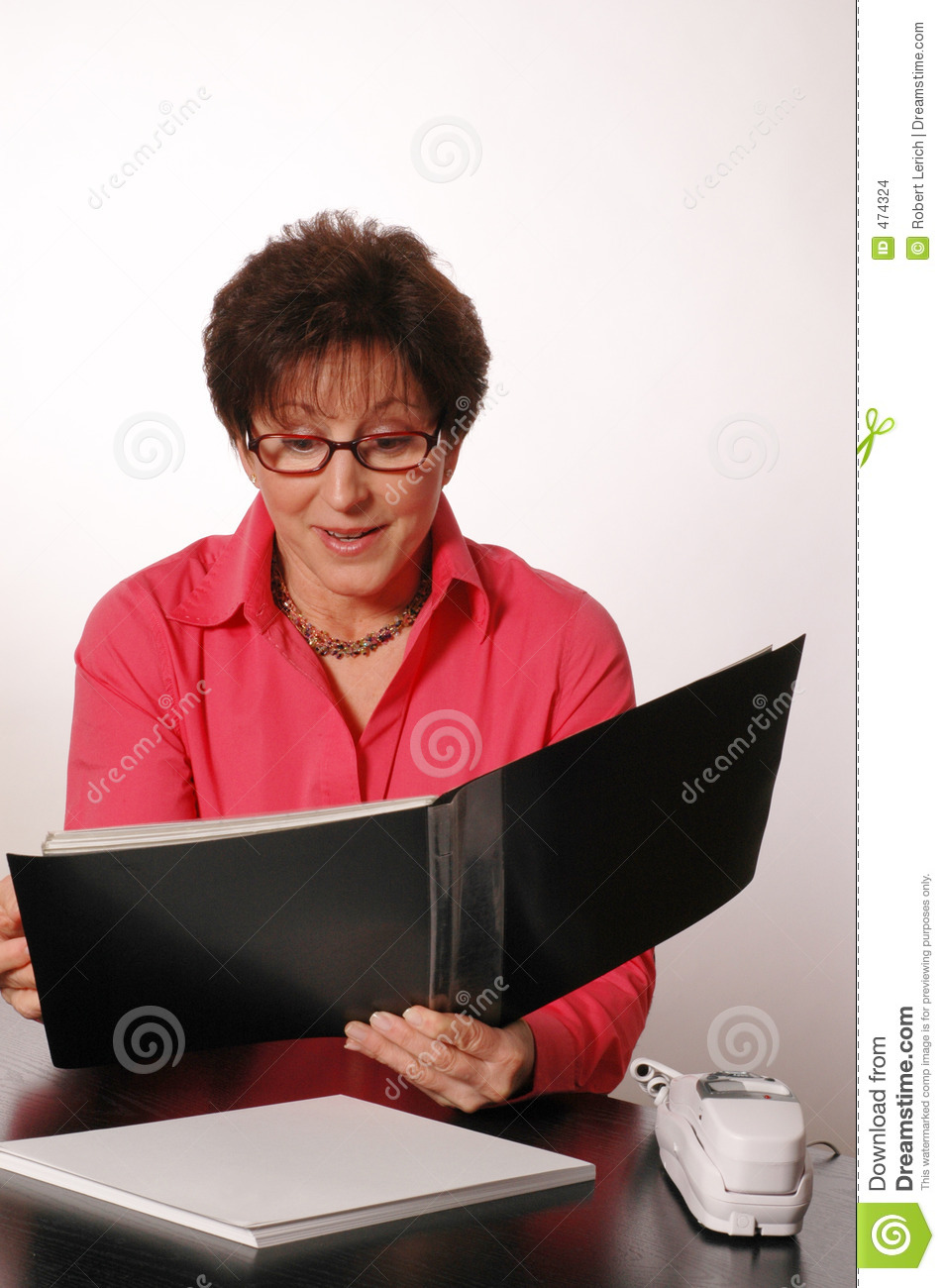 Download Reviewing The Portfolio Female Executive Stock Photo - Image of maker, aged: 474324