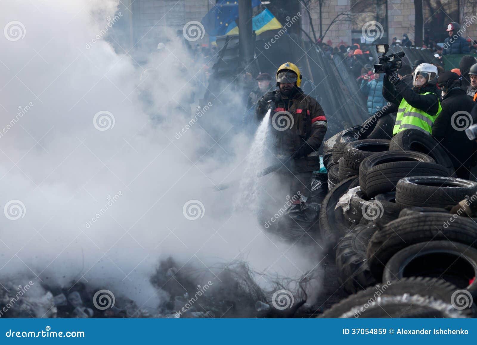 KIEV  UKRAINE - 23 JANUARY 2014  Firefighters extinguish a fire at the    Ukraine Revolution Fire
