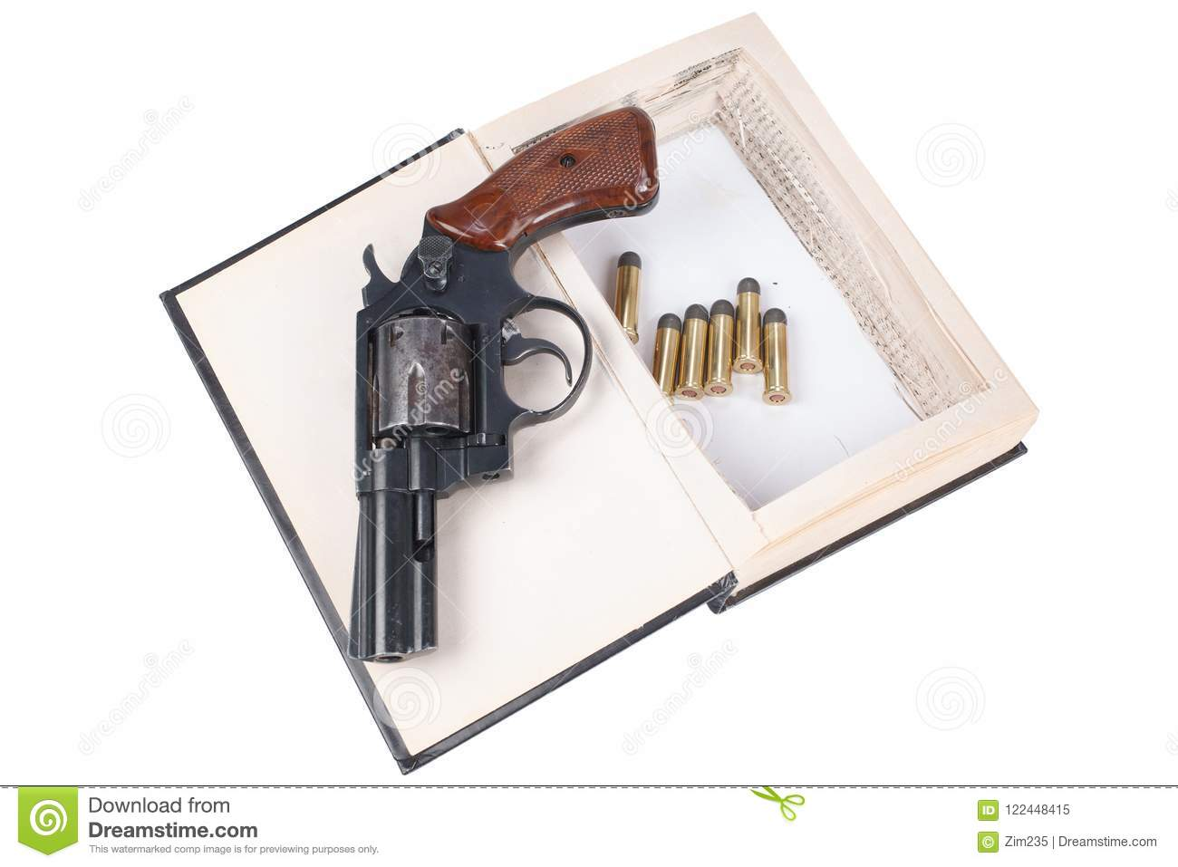 Revolver Gun With Cartridges Hidden In A Book Stock Image