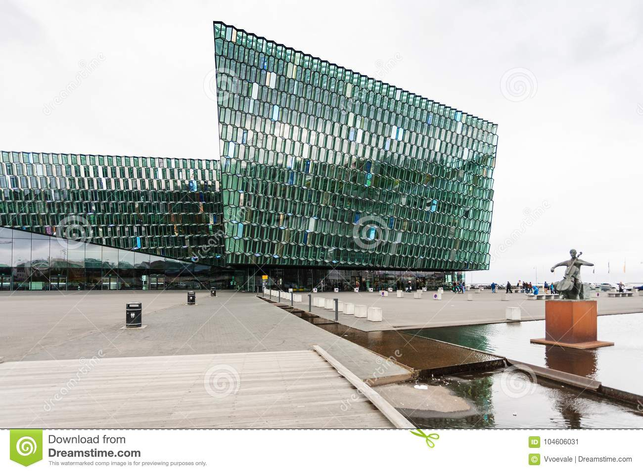 Harpa and cellist statue in Reykjavik city