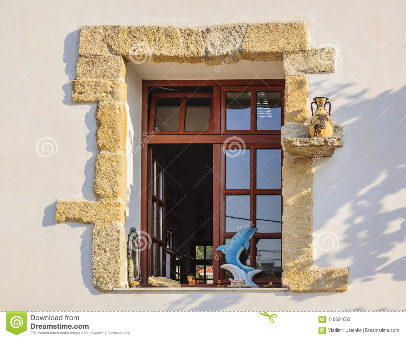 RHODES, GREECE-August 24, 2015: Window in a modern ceramic pottery workshop with elements of decoration