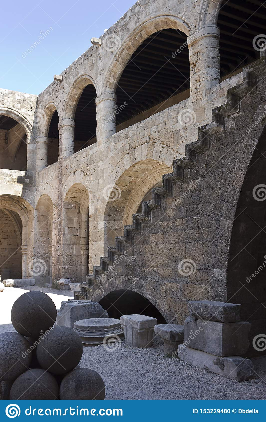 Rhodes Old City - Hospital of the Knights, the main courtyard. The outside stairway leads to the upper floor. Archaeological muse