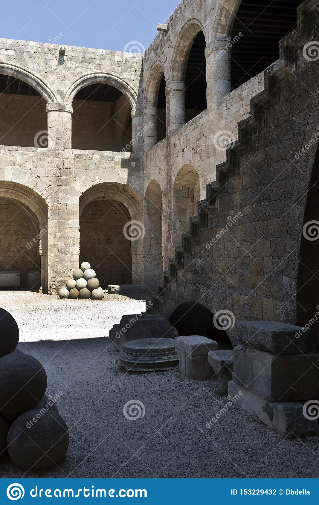 Rhodes Old City - Outside stairway, cannon ball in the main courtyard of Hospital of the Knights. At present Archaeological museu