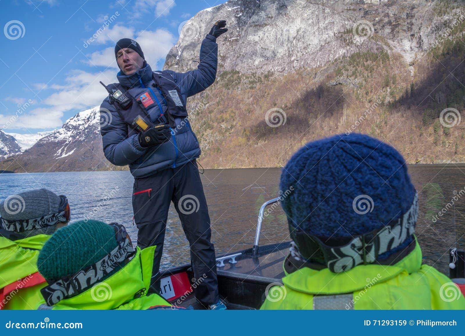 Rib boat operator explaining about the Norwegian fjords