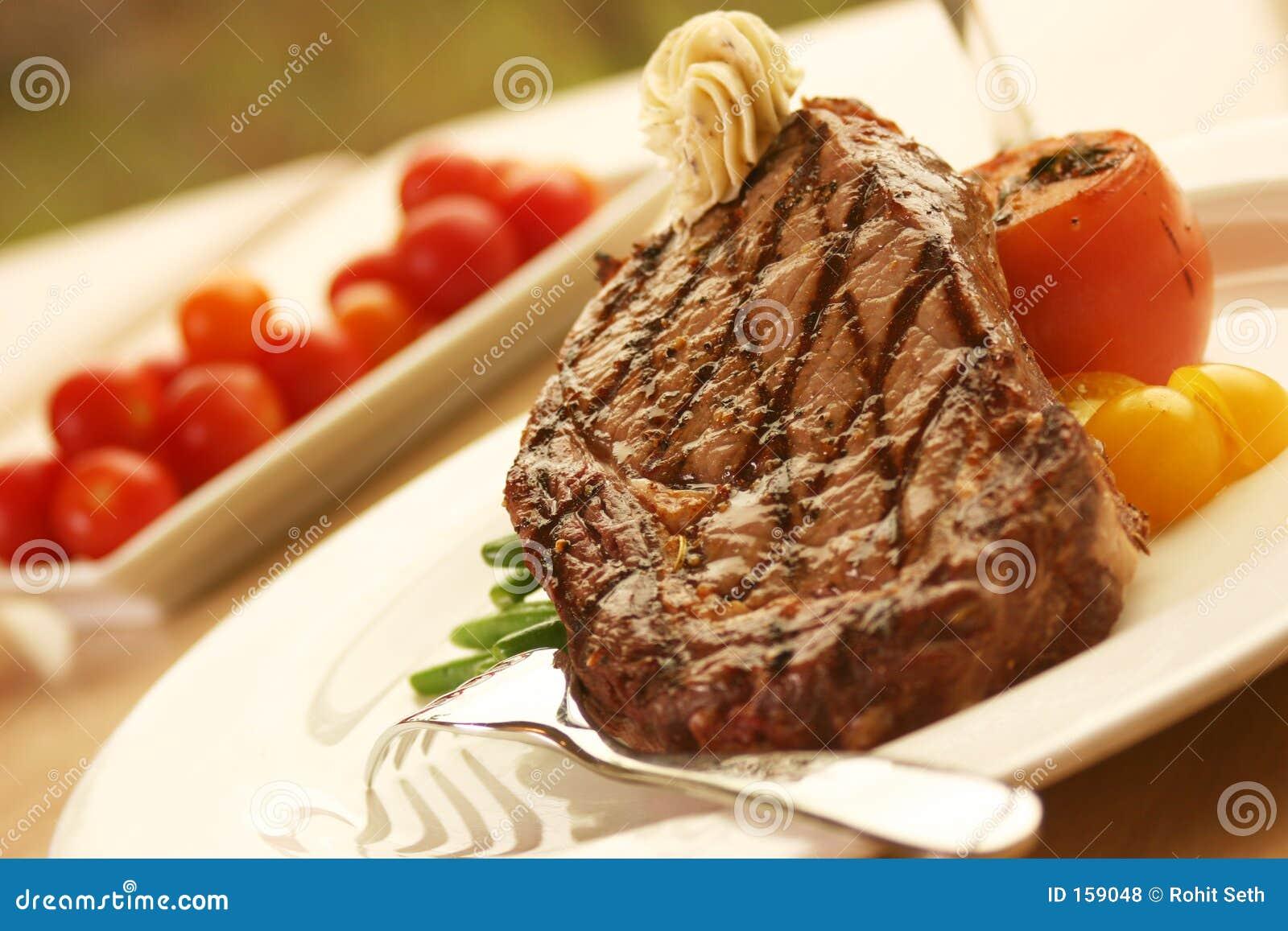 Rib Eye Steak served with wine