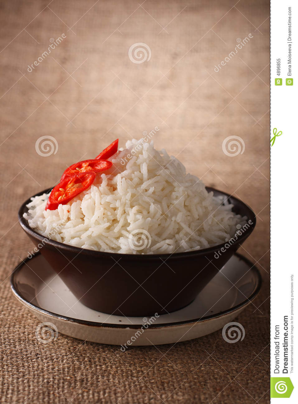 Rice bowl with fresh chillies rustic background