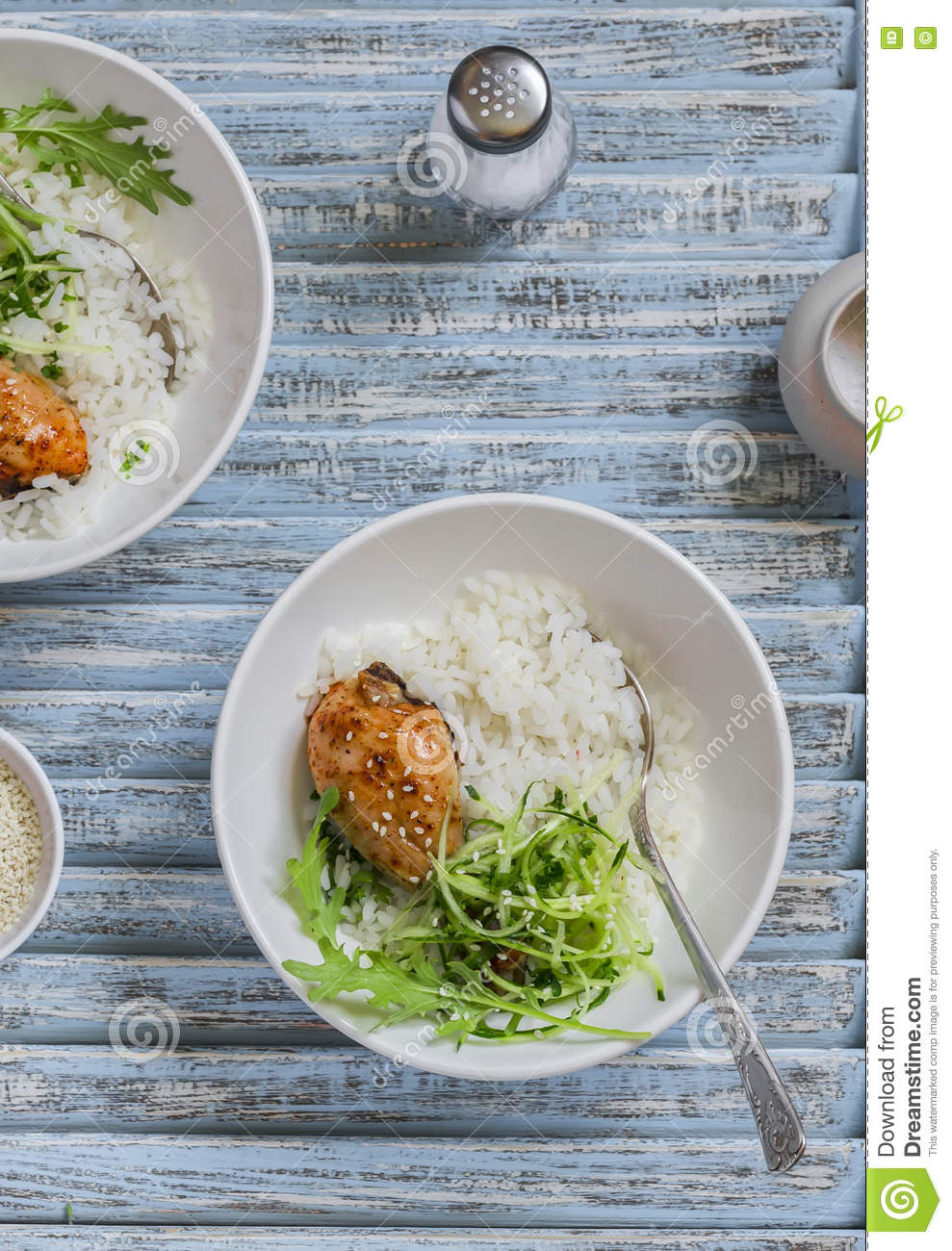 Rice, chicken and salad in a bowl