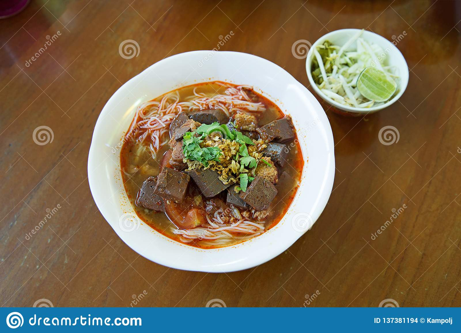 rice noodles with spicy pork sauce, a famous food of