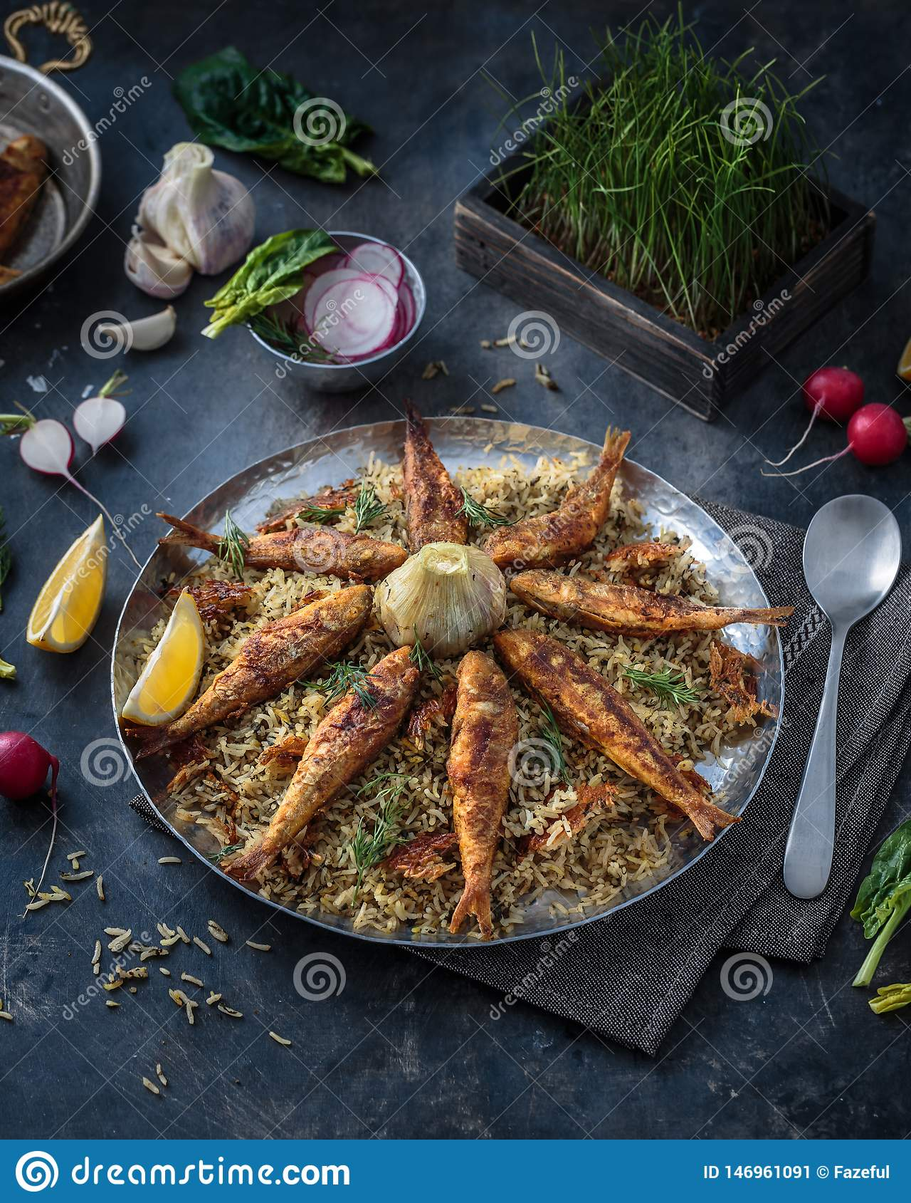 Rice pilaf with different herbs and fish. persian cuisine