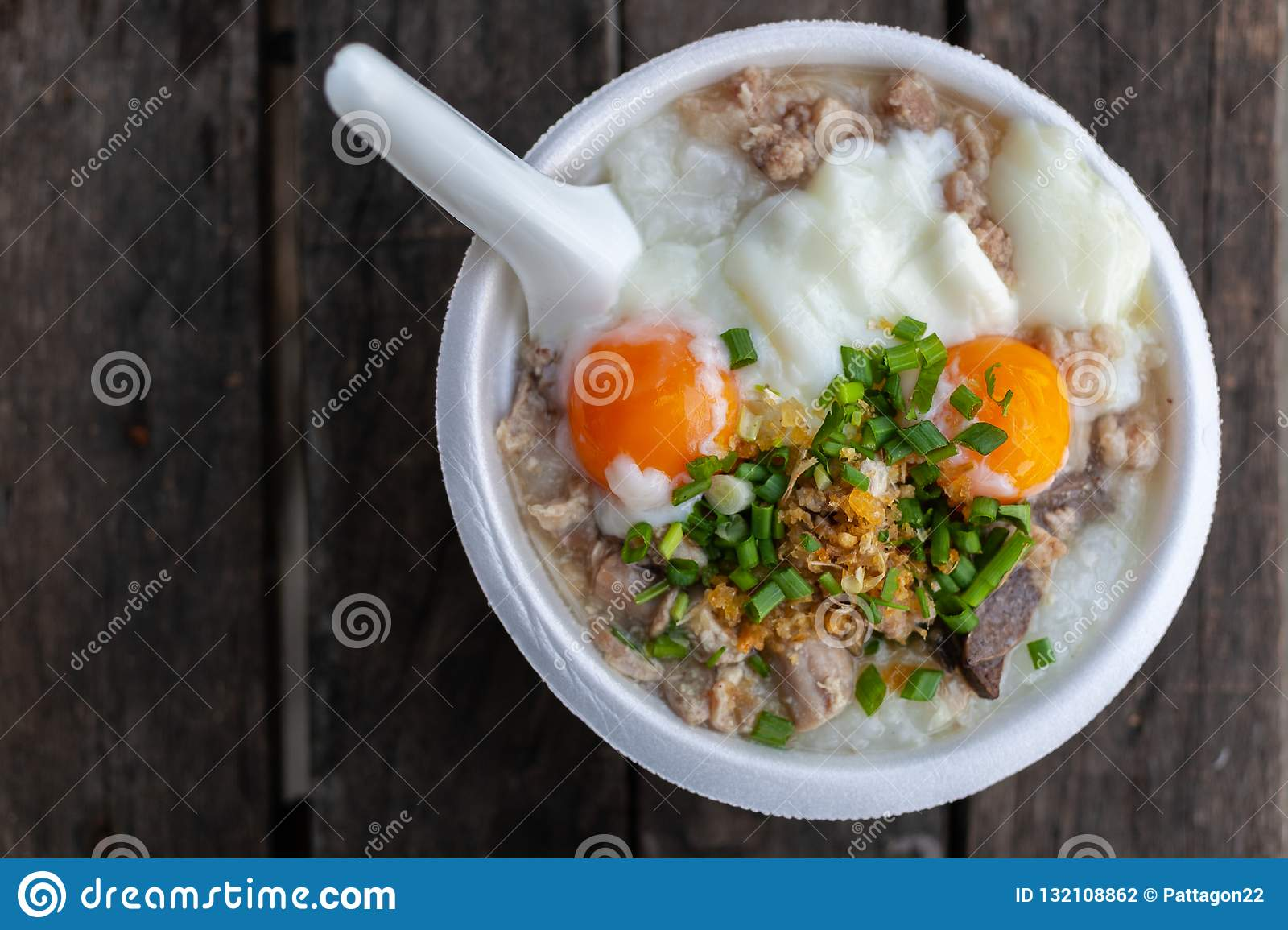 Rice Porridge With Pork Chops And Boiled Egg Stock Photo
