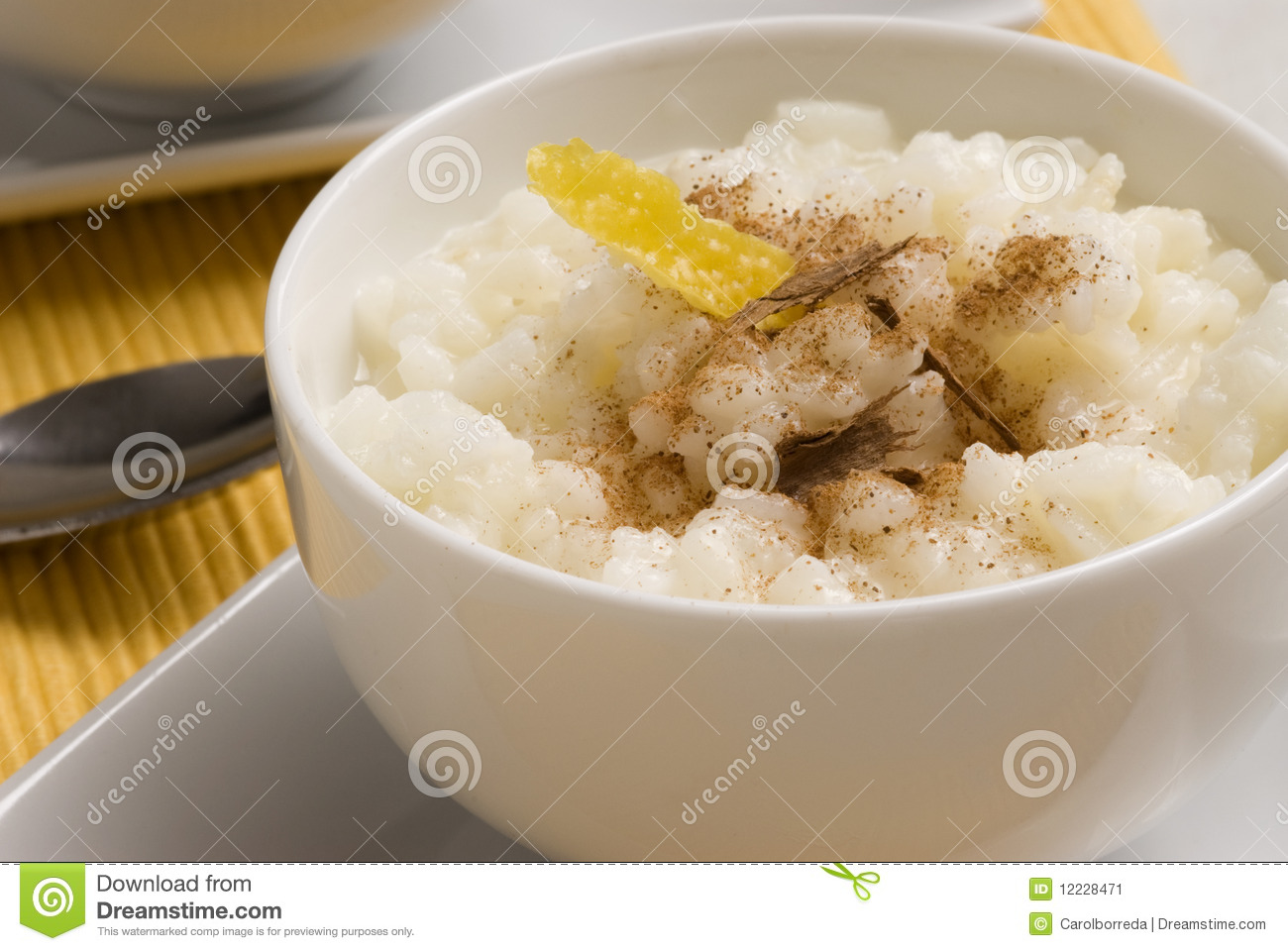 ... bowl with lemon and grated cinnamon. Selective focus. Arroz con leche