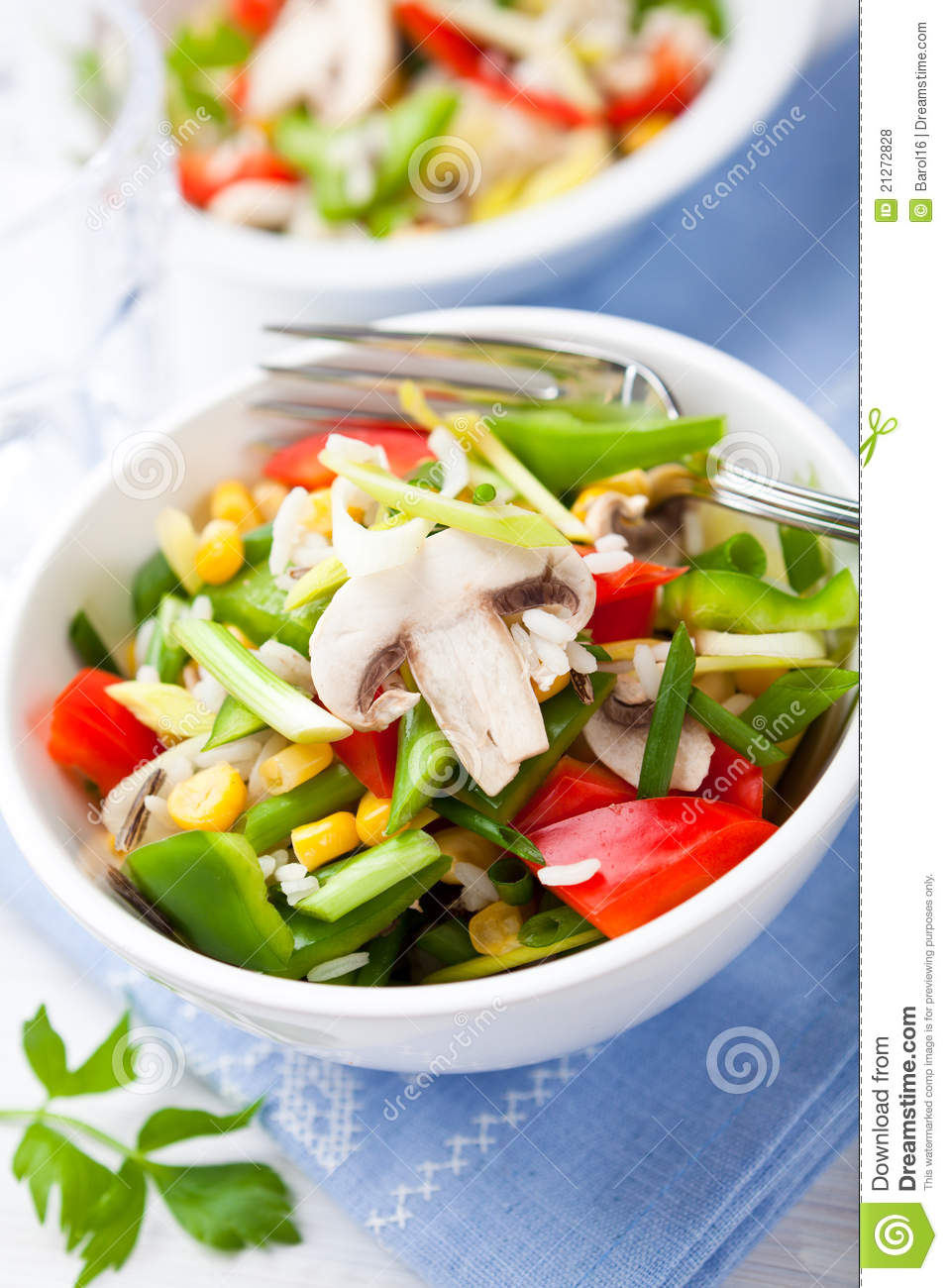 Rice salad with fresh mushrooms and vegetables.