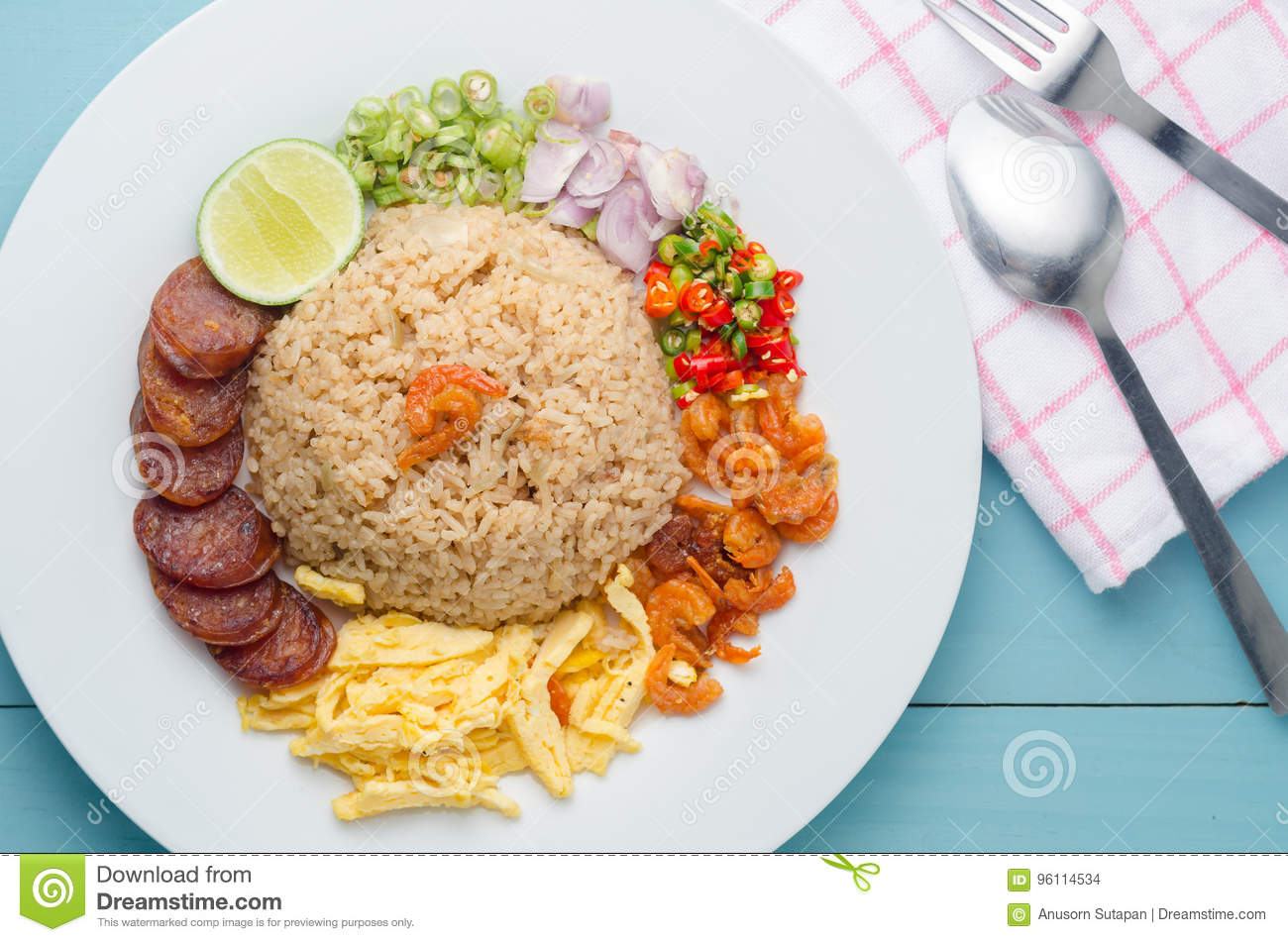 Rice Seasoned with Shrimp Paste, Thai food on white dish over wooden table.