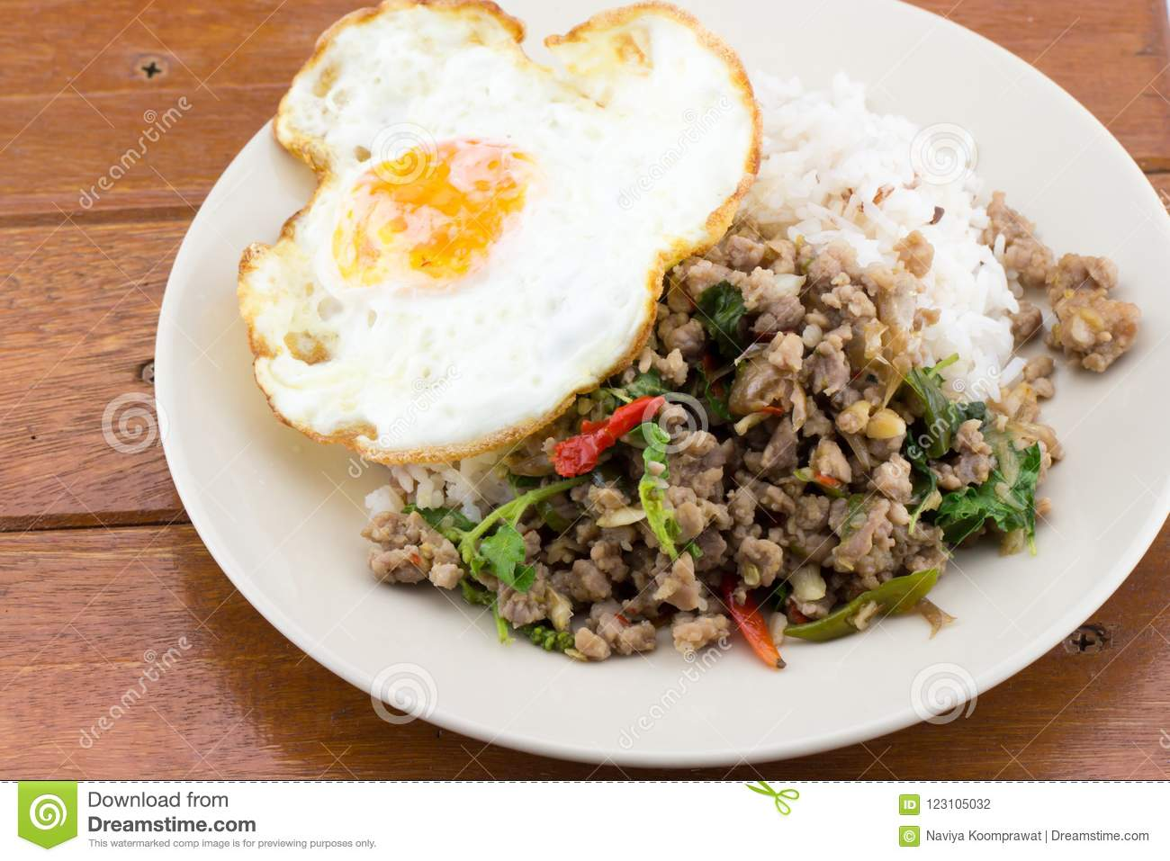 Rice topped with stir-fried pork basil and fried egg