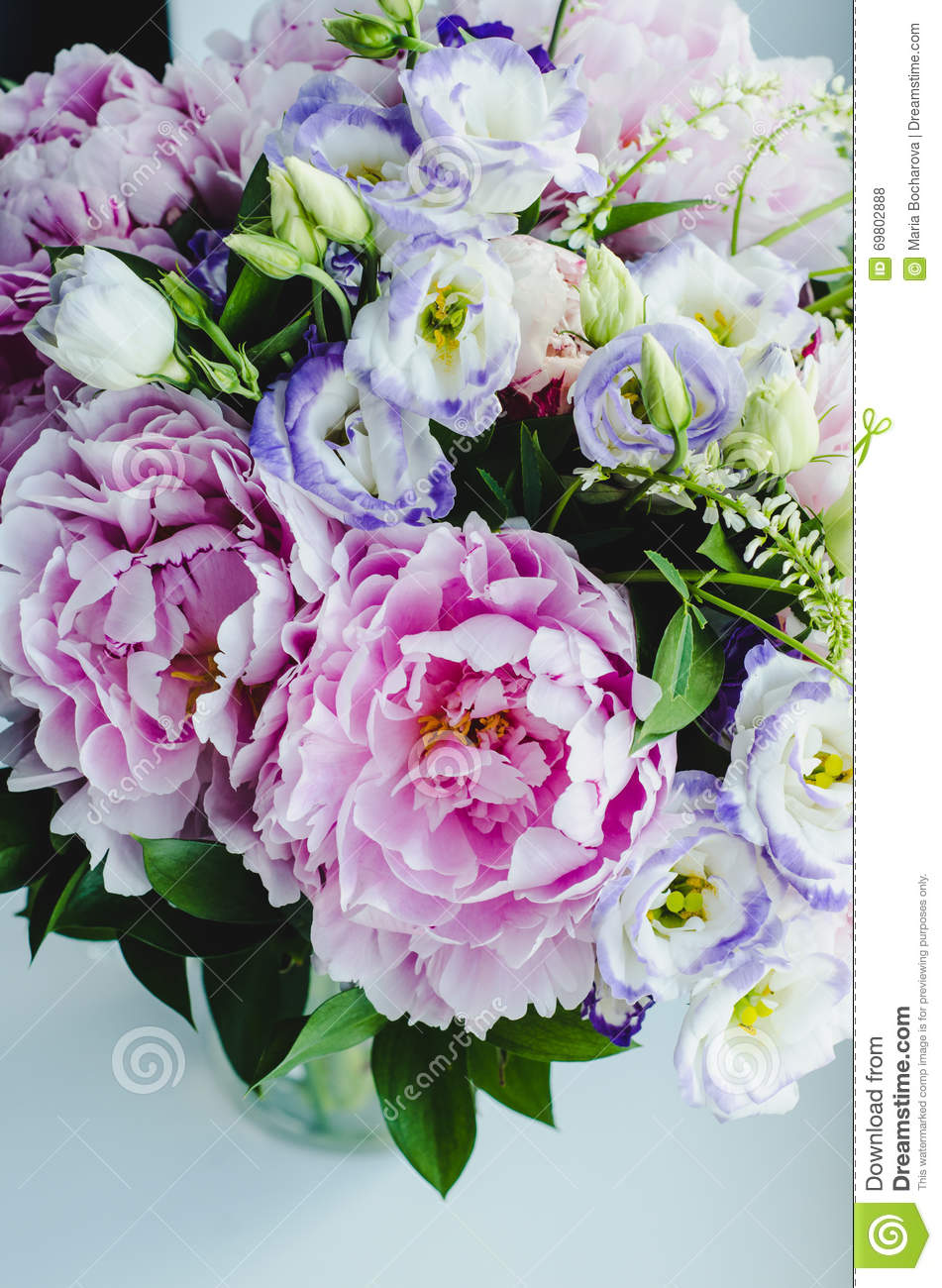 rich bunch of pink peonies peony and lilac eustoma roses