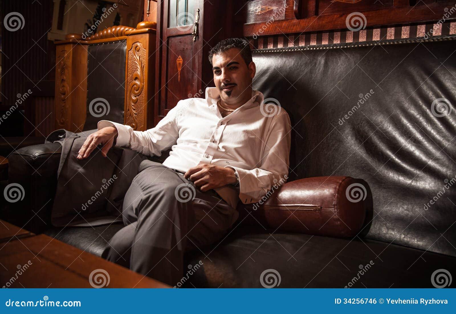 Rich Man Sitting On Vintage Leather Sofa Royalty Free