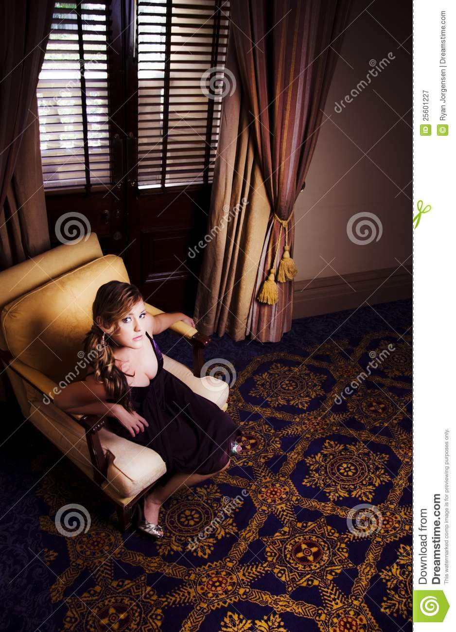 Rich wealthy woman sitting in upmarket hotel royalty free for Upmarket hotel
