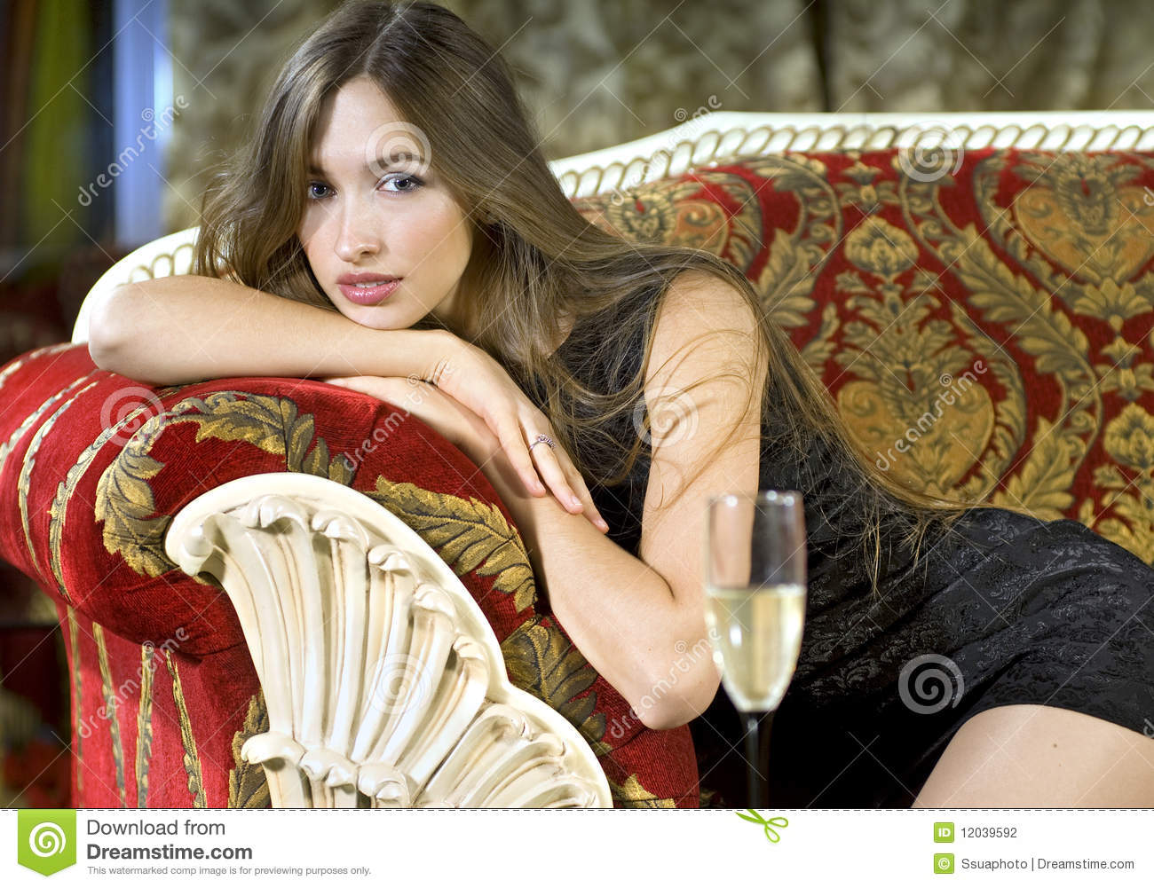 Rich Woman On A Red Expensive Sofa Stock Photography - Image: 12039592